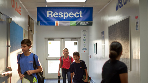 Students Walking through the Hall Under Respect Banner
