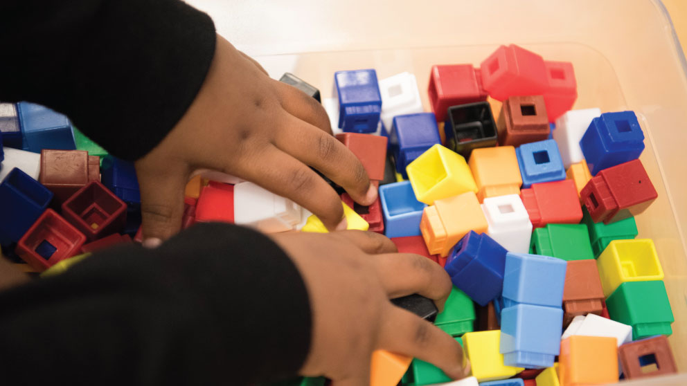 Child using connecting blocks