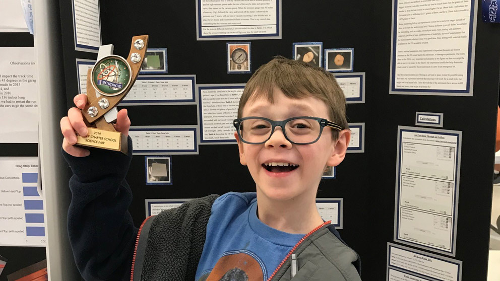 Student with science award