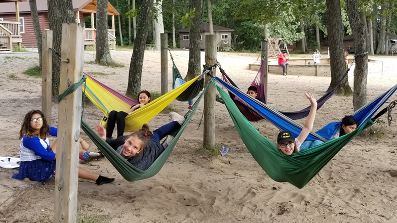 Students in camping hammocks