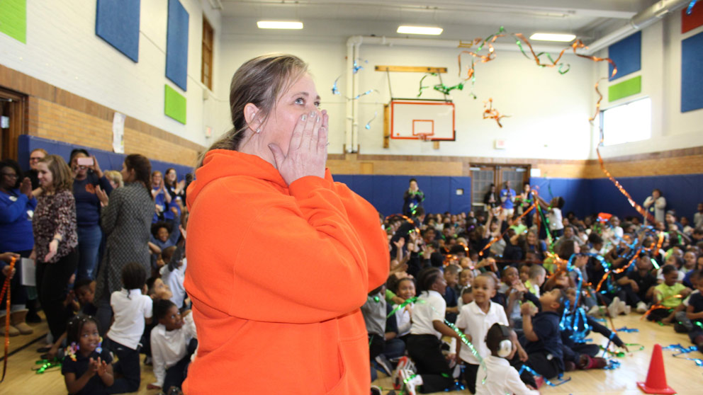 Teacher at surprise award assembly