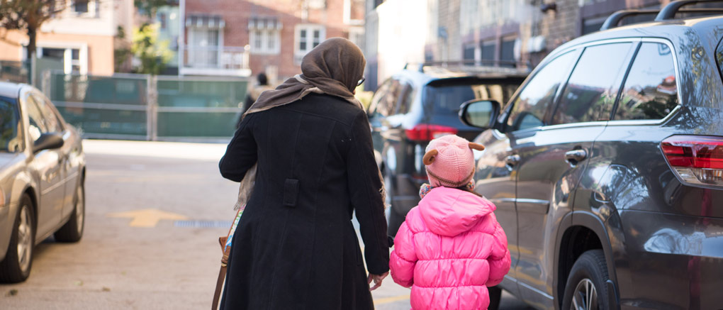 Parent walking with child to car