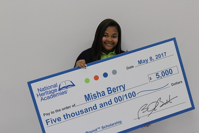student holding check