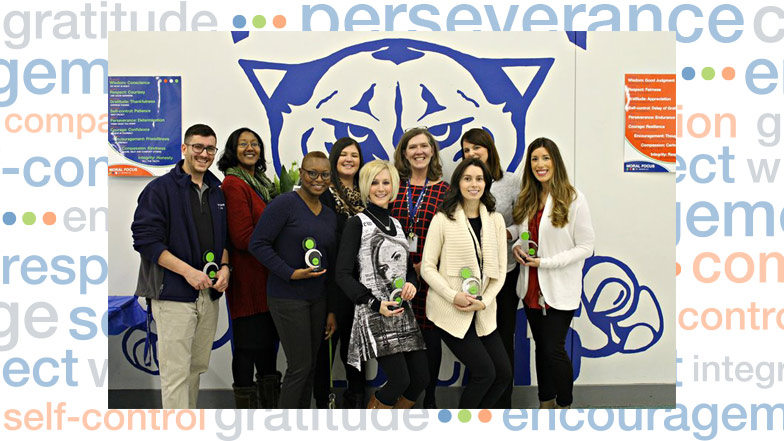 Group of teachers with awards