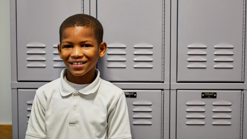 Student smiling in hallway