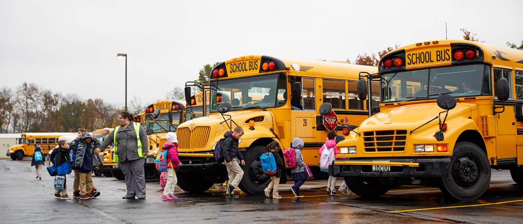 Students boarding buses