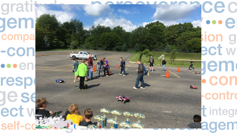 Students racing remote control cars