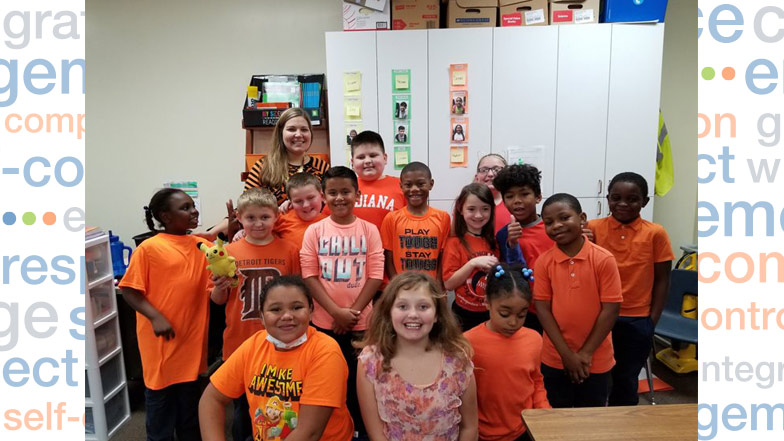 group of students wearing orange shirts