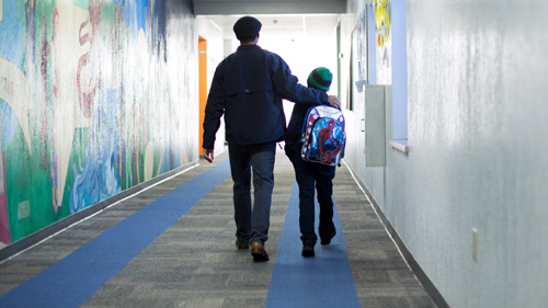 Parent walking with student