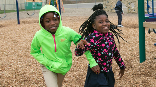 Two students enjoying recess