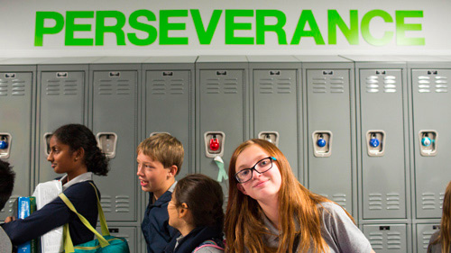 Students under Perseverance sign