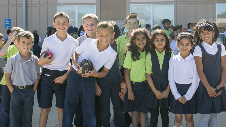 Students smiling outside