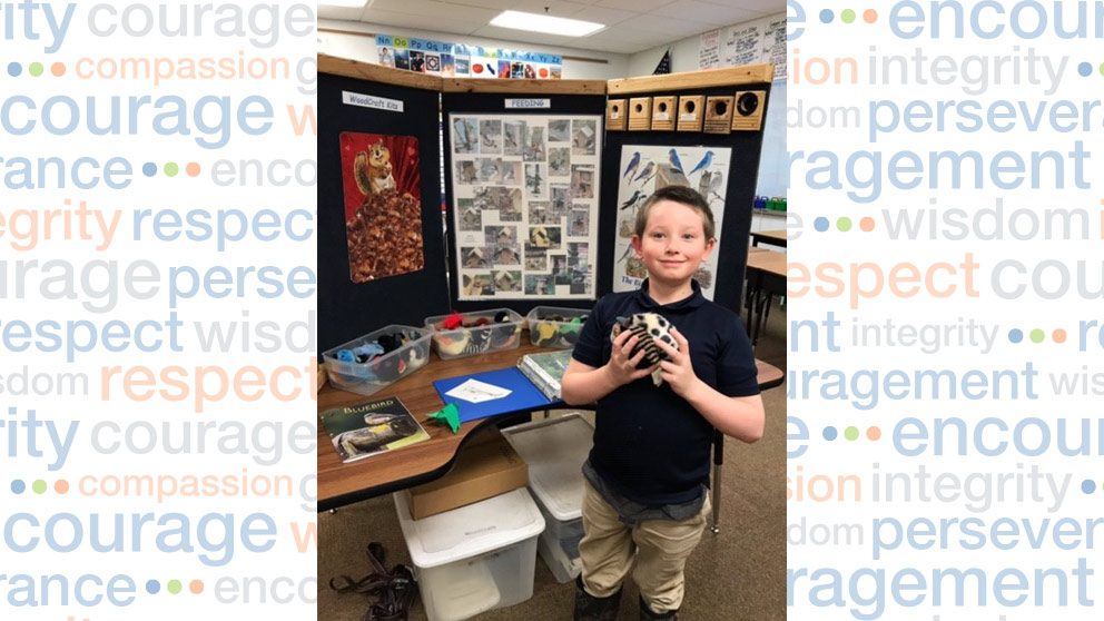 Student with science display